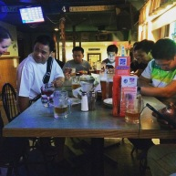 This is a photo at O'Brien's Restaurant and Pub in Clayton, N.Y. Some of the staff of the Pearl Mist cruise ship were celebrating a birthday with pizza, beer and a game or two of pool. This photo was taken on Friday, July 17, 2015 by Matthew Aaron Lewis. © Matt Lewis 2015.