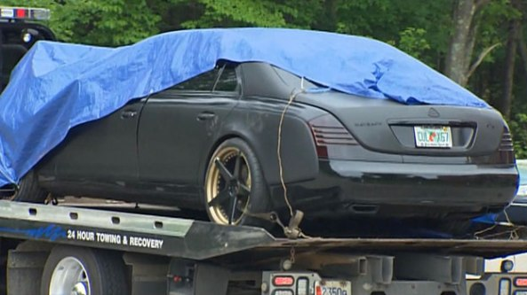 The car owned by Brandon Spikes towed by State Police after the June 7 crash. (WBZ-TV)